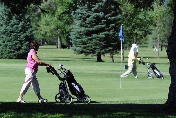 "Elise Ostenak, left, and her husband, Carl, play at Flatirons Golf Course in Boulder on Tuesday.<br /> For more photos and video of  two local golf courses, go to  <a href=""http://www.dailycamera.com"">http://www.dailycamera.com</a>.<br /> Cliff Grassmick / June 28, 2011"