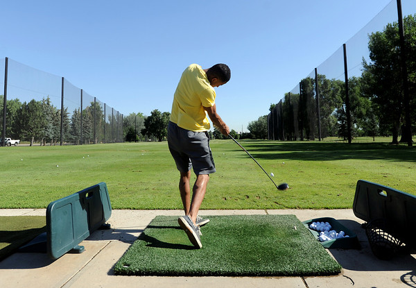 """Brandon Messenger practices his tee shot at Flatirons Golf Course in Boulder on Tuesday.<br /> For more photos and video of  two local golf courses, go to  <a href=""""http://www.dailycamera.com"""">http://www.dailycamera.com</a>.<br /> Cliff Grassmick / June 28, 2011"""