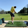 "Brandon Messenger practices his tee shot at Flatirons Golf Course in Boulder on Tuesday.<br /> For more photos and video of  two local golf courses, go to  <a href=""http://www.dailycamera.com"">http://www.dailycamera.com</a>.<br /> Cliff Grassmick / June 28, 2011"