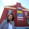 Bora Chiemruom of Boston, who grew up in Lowell, at the building in Cambodian Town on Branch Street, where she'll be opening Kravant Boutique, a dress rental and consignment business. Grand opening is May 12. (SUN/Julia Malakie)
