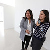 Bora Chiemruom of Boston, left, who grew up in Lowell, shows EforAll-Lowell-Lawrence executive director Lianna Kushi, the second floor space in Cambodian Town on Branch Street, where she'll be opening Kravant Boutique, a dress rental and consignment business.  (SUN/Julia Malakie)