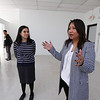 Bora Chiemruom of Boston, right, who grew up in Lowell, shows EforAll-Lowell-Lawrence executive director Lianna Kushi, and CMAA executive director Sovanna Pouv,i the second floor space in Cambodian Town on Branch Street, where she'll be opening Kravant Boutique, a dress rental and consignment business.  (SUN/Julia Malakie)