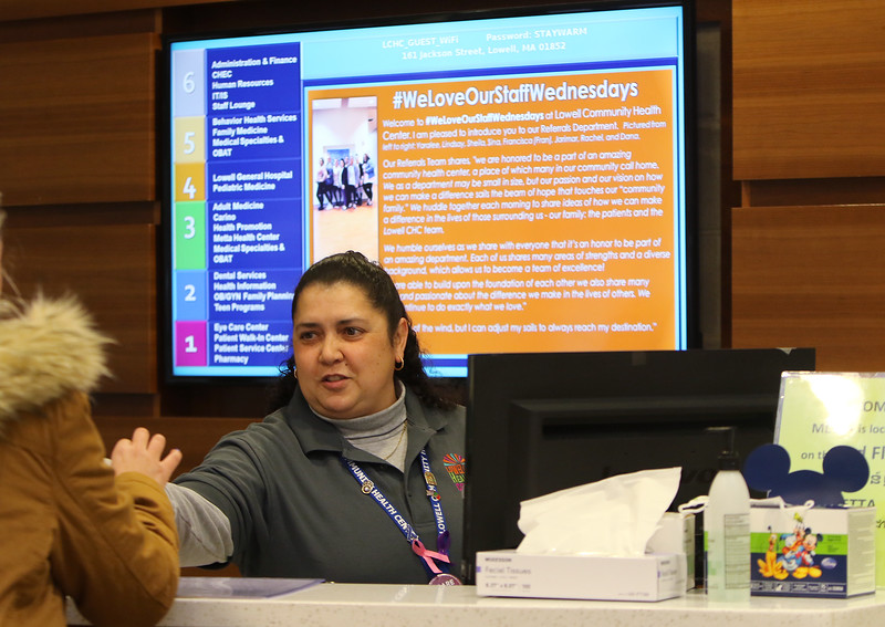 LCHP 50th anniversary year. Lisa Sousa works at the reception desk at Lowell Community Health Plan. (SUN/Julia Malakie)