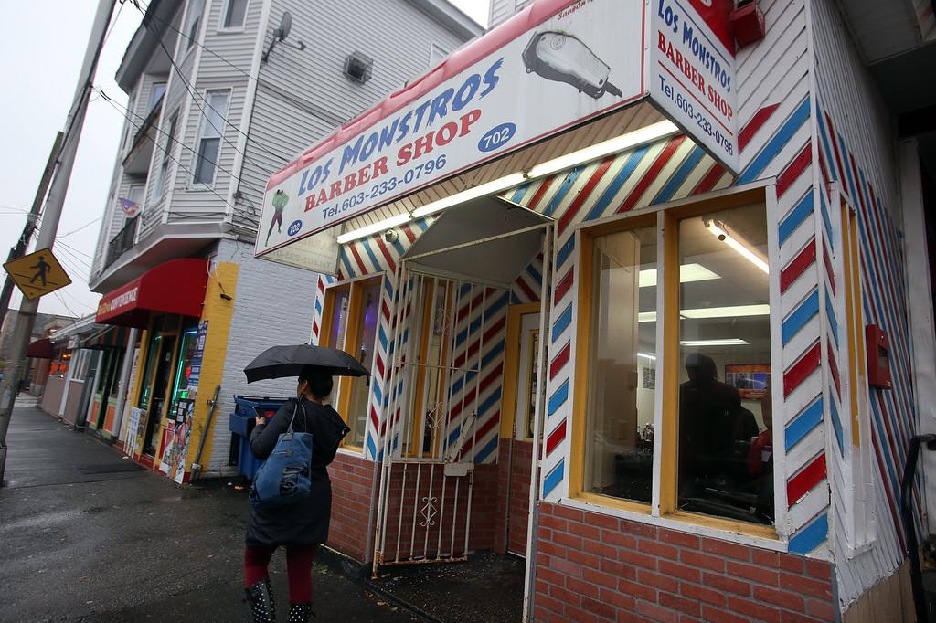 . Los Monstros Barber Shop on Merrimack Street in Lowell.  (SUN/Julia Malakie)