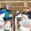 For the remainder of the year, Market Basket is giving shoppers four percent off each grocery order. Cashier Maria Rodriguez rings up Stan Skamarycz, 85, of Westminster on Monday in the store on Water Street in Fitchburg. SENTINEL & ENTERPRISE/JOHN LOVE