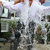 Water Street Market Basket 's Assistant Store Director Jim St. Cyr and Full time Clerk Eric Peters dump water on the store Director John Sevastis for the ALS Ice Bucket Challenge. SENTINEL & ENTERPRISE/JOHN LOVE