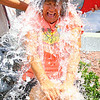 Water Street Market Basket 's Assistant Store Director Jim St. Cyr and Head Cashier Greg Beleza dump water on the store's Gorcery Clerk Peggy Proietti for the ALS Ice Bucket Challenge. SENTINEL & ENTERPRISE/JOHN LOVE