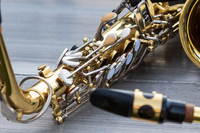 close up of an alto sax resting for a moment during an evening rehearsal