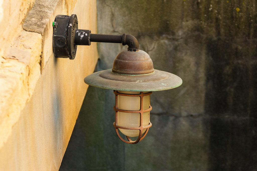 old outdoor light fixture in a stairwell