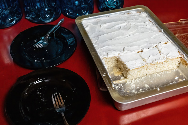 serving up a traditional vanilla white cake after  dinner