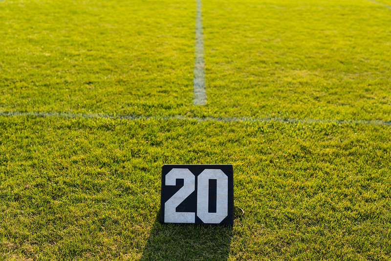 twenty yard line marker at an evening rehearsal