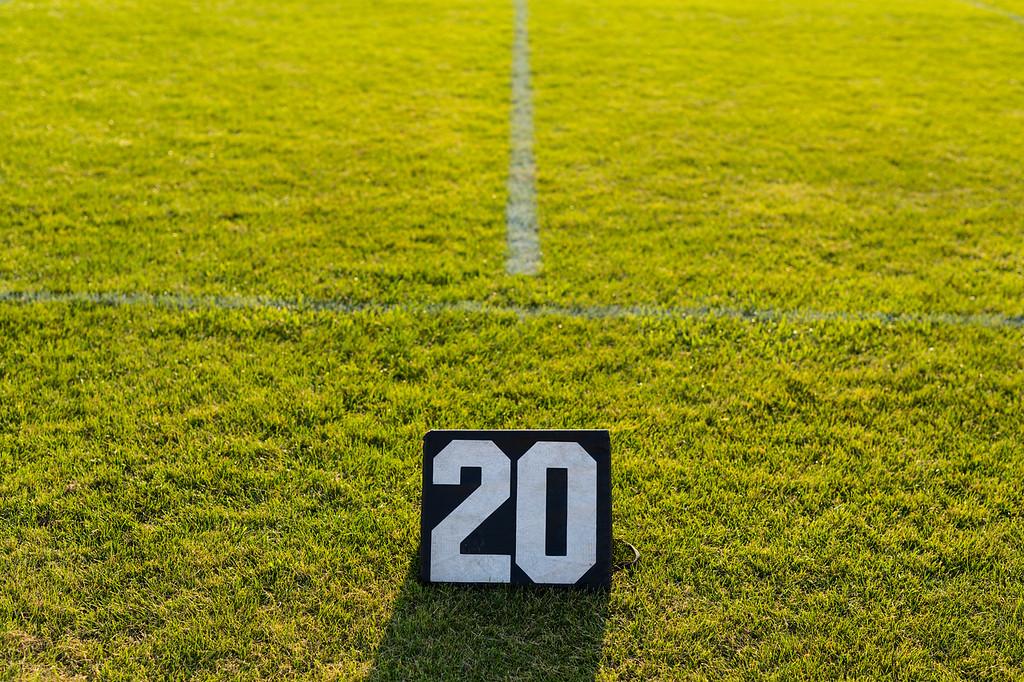 twenty yard line marker at an evening rehearsal