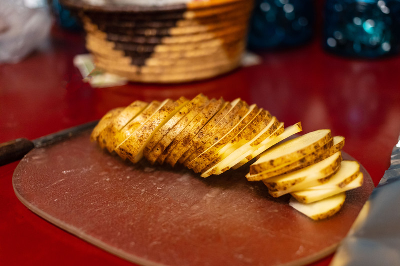 single sliced russet potato getting prepared for cooking