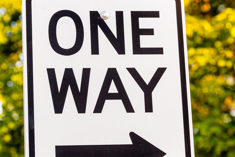 close up of a one way sign