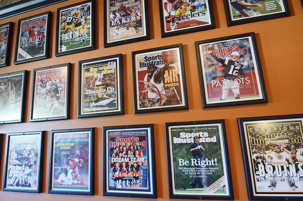 . A collection of historic and contemporary Sports Illustrated covers decorate Mazcots in Lenox, Friday September 20, 2013. Ben Garver / Berkshire Eagle Staff