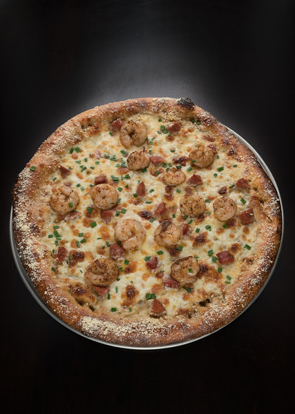 Bayou Bleu, <br /> Spicy bleu cheese base topped with all natural grilled shrimp and Andouille sausage covered in mozzarella cheese and garnished with chives.