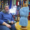 Penny Godin of the Merry Weaver in Leominster chats about her store on Friday Morning. In front of her is the fingerless gloves she is making as holiday gifts for seniors with brain injuries. SENTINEL & ENTERPRISE/JOHN LOVE