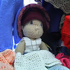 Penny Godin of the Merry Weaver in Leominster has some dolls made out of yarn by her son. SENTINEL & ENTERPRISE/JOHN LOVE