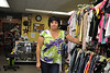 Maria Carmain, owner of Mia's Exchange on Eagle Street, stands next to the various clothes sold in her store. The store is celebrating its 15th anniversary.<br /> (Jack Guerino/ North Adams Transcript)