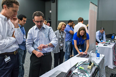 Leon Braginsky (Microsoft) discusses the finer points of Windows 8 with David White (HP) with the HP Envy UltraBook 4.