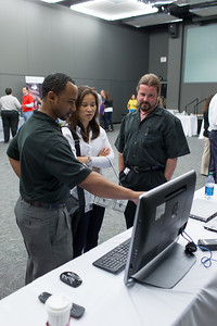 Charles Jones (Left) and Rob Rodon, both with HP TCE/Q, discuss Windows 8 running on a new HP Envy 23 TouchSmart.
