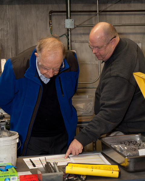 Eric Youngquist reviews quality documentation with Harold Denton.