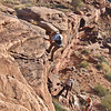 Moab, Utah and American Mountain Guides Association meetings October 30, 2009 to November 1, 2009 - The Transgender River Guide Nerd Alliance Team rappel off improvised anchor