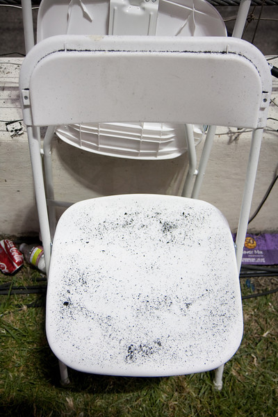 A chair next to the racetrack at camera position four accumulates flying rubber with nearly every passing car.