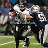 22 January 2012.  Ravens Quarterback Joe Flacco (5) in the grasp of Patriot Linebacker Rob Ninkovich (50) in the third quarter.  The New England Patriots defeated the Baltimore Ravens 23 to 20 in the AFC Championship game.  The game was played in Gillette Stadium, Foxboro, Massachusetts. <br /> (c) Tom Croke/Visual Image Inc.