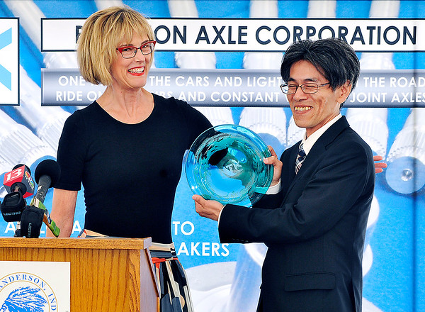 John P. Cleary |  The Herald Bulletin<br /> Indiana Lt. Governor Suzanne Crouch presents a gift from the state to Takayuki Yoshikuni, president of NTK Precision Axle Corp., during the official groundbreaking ceremony Wednesday for NTK's new production facility being built in Anderson.