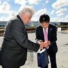 John P. Cleary |  The Herald Bulletin<br /> Anderson Mayor Thomas Broderick Jr. and Hironori Inoue, executive vice president of NTN Driveshaft, exchange gifts and business cards before the start of the NTK Precision Axle groundbreaking ceremony Wednesday.