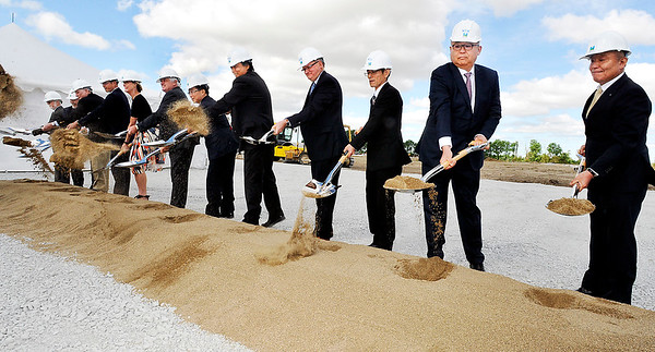 John P. Cleary    The Herald Bulletin<br /> Executives from NTK Precision Axle Corp., along with city and state dignitaries, broke ground Wednesday for a $98 million, 300,000 square-foot manufacturing facility in Anderson.
