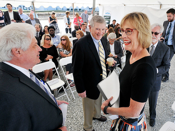 John P. Cleary |  The Herald Bulletin<br /> Anderson Mayor Thomas Broderick Jr. talks with Indiana Lt. Governor Suzanne Crouch before the start of the NTK Precision Axle groundbreaking ceremony as Jim Ault and State Senator Tim Lanane, background, look on.