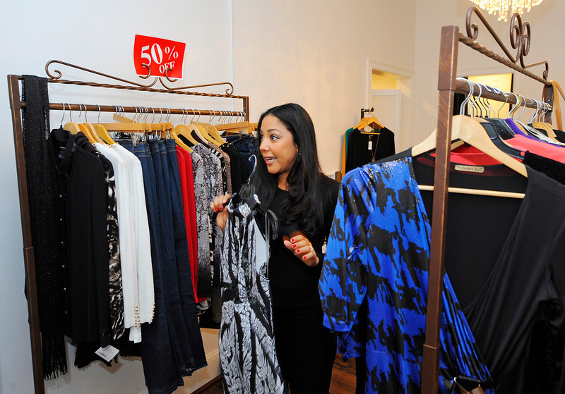 Owner Natalia Fernandes, 30, talks about the clothing that she sells in her store, Nati Celebrity Styles Boutique, located at 18 Central St. in Leominster, Thursday.<br /> SENTINEL & ENTERPRISE / BRETT CRAWFORD