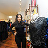 Owner Natalia Fernandes, 30, sands with clothing sold in her store, Nati Celebrity Styles Boutique, located at 18 Central St. in Leominster, Thursday.<br /> SENTINEL & ENTERPRISE / BRETT CRAWFORD