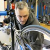A new bike shop called Tomten Biketown just opened up in Leominster on Central Street. Head Mechanic Michael Spanner works on a bike in the new shop on Tuesday morning. SENTINEL & ENTERPRISE/JOHN LOVE