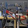 A new bike shop called Tomten Biketown just opened up in Leominster on Central Street. Bike Technician Dan Lawler works on a bike in the new shop on Tuesday morning. SENTINEL & ENTERPRISE/JOHN LOVE