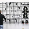 A new bike shop called Tomten Biketown just opened up in Leominster on Central Street. Manager Daren Smith fills a wall with some bike handle bars in the new shop on Tuesday morning. SENTINEL & ENTERPRISE/JOHN LOVE