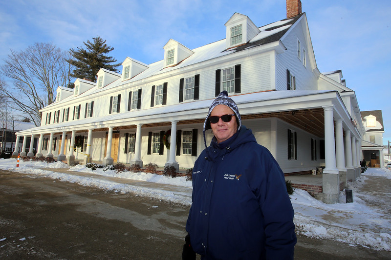 "Warren ""Waddy"" Francis, general manager of the new Groton Inn, gives a tour around the exterior. The Inn is scheduled to open in early May. The previous, historical Groton Inn was destroyed in a 2011 fire. (SUN/Julia Malakie)"