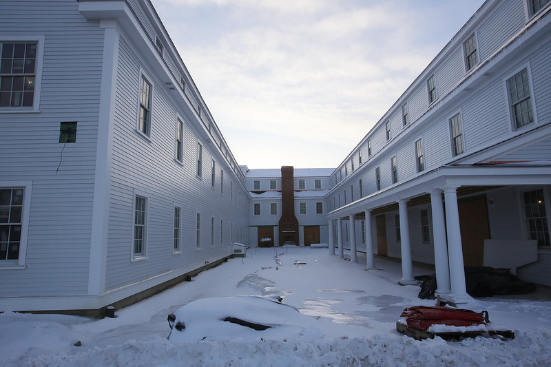 A new courtyard, with an outdoor fireplace, in the back of the new Groton Inn, which is scheduled to open in early May. The previous, historical Groton Inn was destroyed in a 2011 fire. (SUN/Julia Malakie)