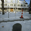 The new Groton Inn, scheduled to open in early May. The previous, historical Groton Inn was destroyed in a 2011 fire. In front of the sidewalk is a restored mile marker that shows miles to Boston. (SUN/Julia Malakie)
