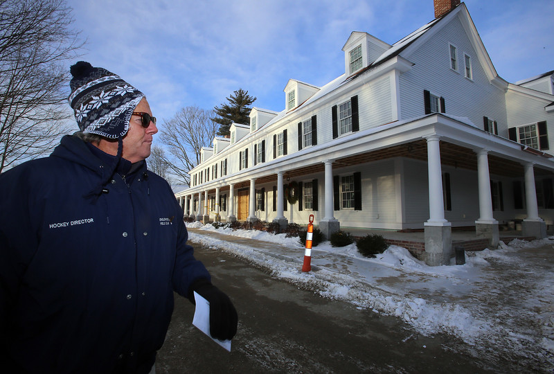 """Warren """"Waddy"""" Francis, general manager of the new Groton Inn, gives a tour around the exterior. The Inn is scheduled to open in early May. The previous, historical Groton Inn was destroyed in a 2011 fire. (SUN/Julia Malakie)"""