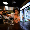 KRISTOPHER RADDER - BRATTLEBORO REFORMER<br /> Alex Fraser, owner of North Country General, pours a glass of wine on Thursday, May 18, 2017.