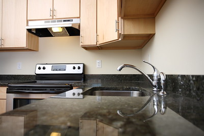 North Dam Mill apartments - Granite countertops, modern hardware and stainless appliances.