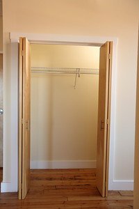 North Dam Mill apartments - Closet off living room.
