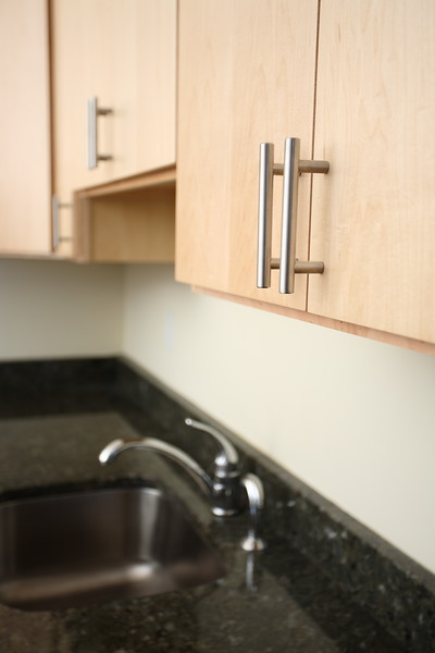 North Dam Mill apartments - Modern cabinets and fixtures.