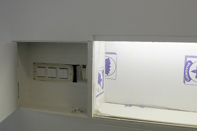 Concealed light switch next to niche in main cooridor