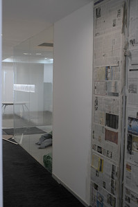 Looking North up main cooridor.  Storage covered in Newspaper to the right, meeting room see on the left.
