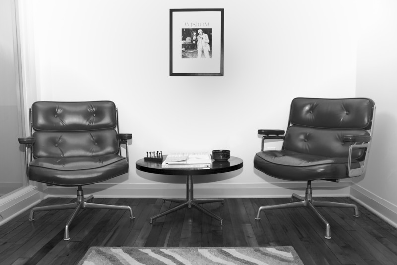 Reception area of an urban office. Black and white to highlight the swanky retro design.