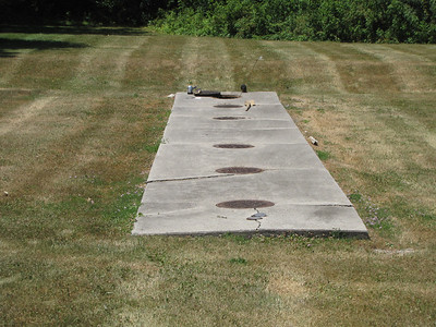 Concrete pad over tanks.